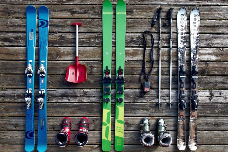 Skis on a wooden background