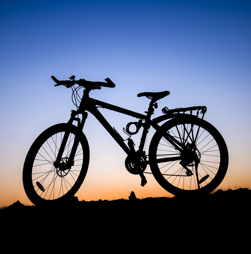 Bicycle rented at Morassi sport in backlight at sunset
